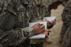 soldiers taking notes